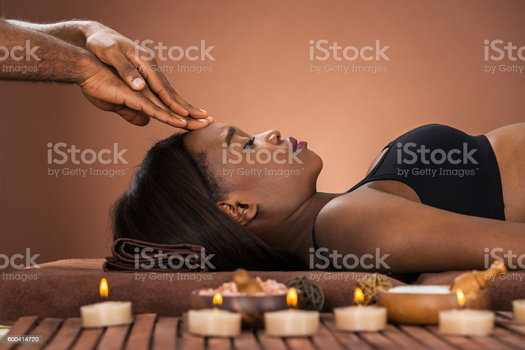 Woman Receiving Forehead Massage stock photo