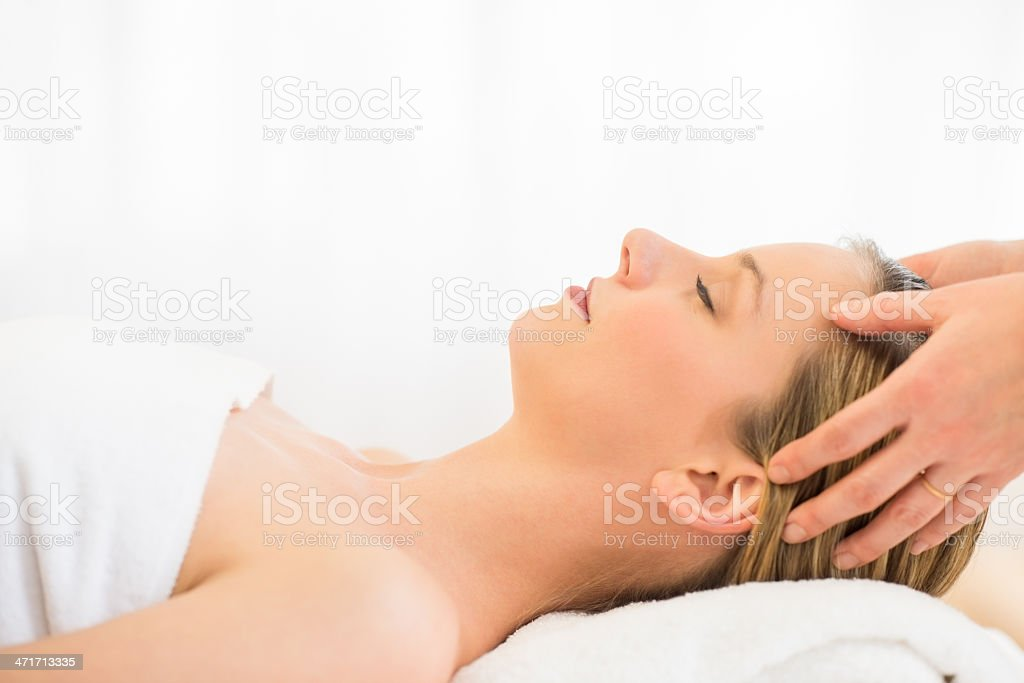 Woman Receiving Head Massage At Health Spa royalty-free stock photo
