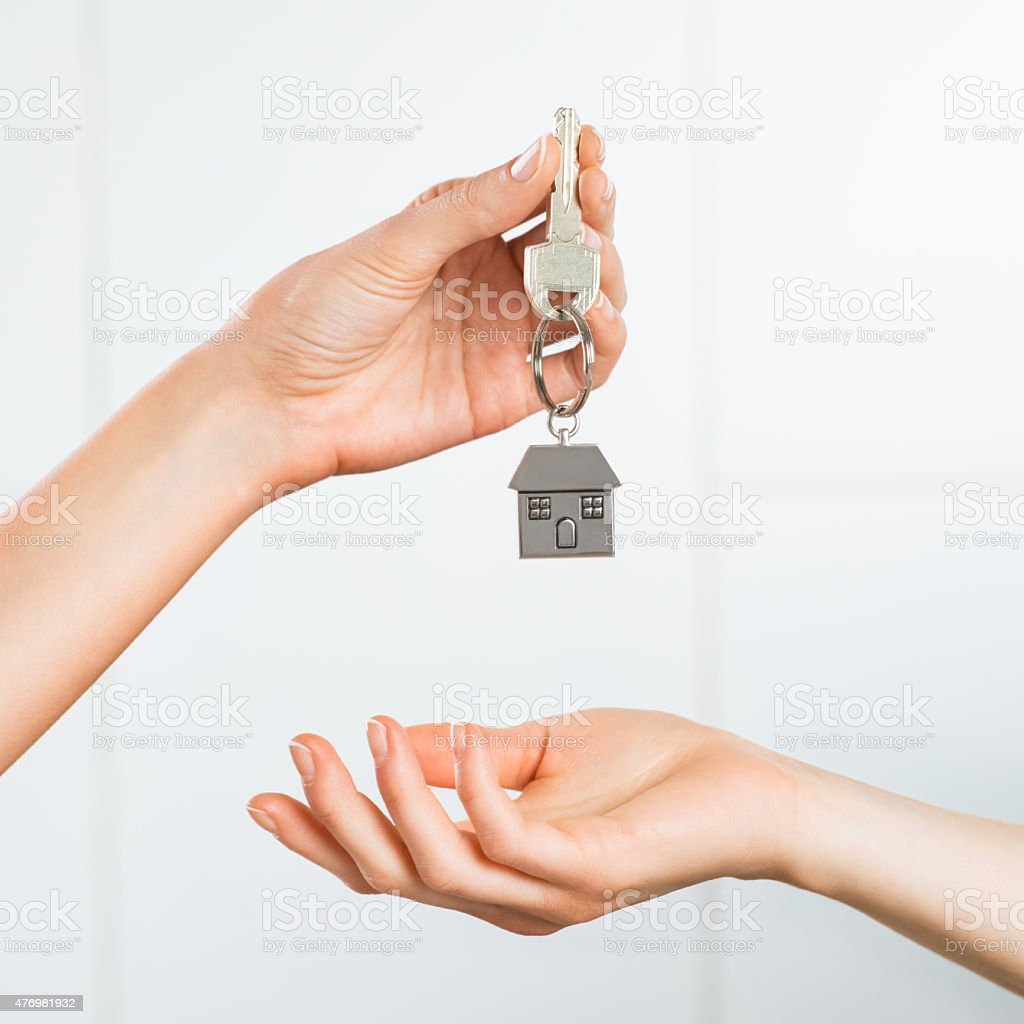 Woman receiving house key stock photo