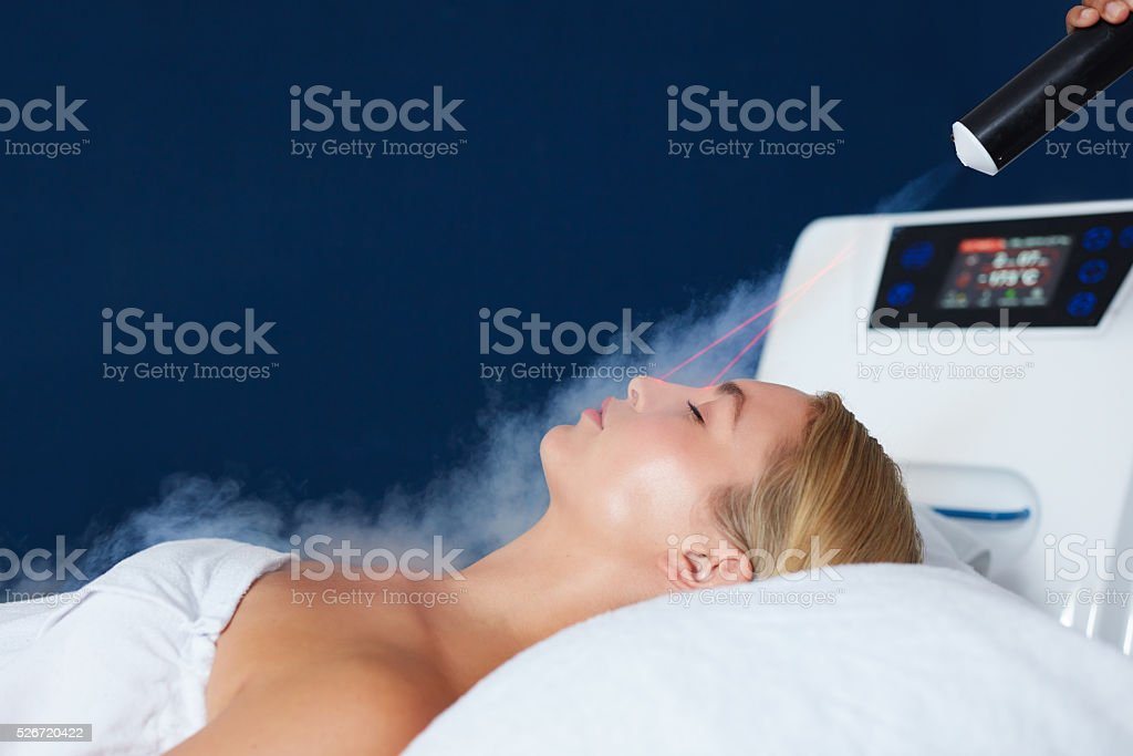 Woman receiving local cryotherapy therapy stock photo