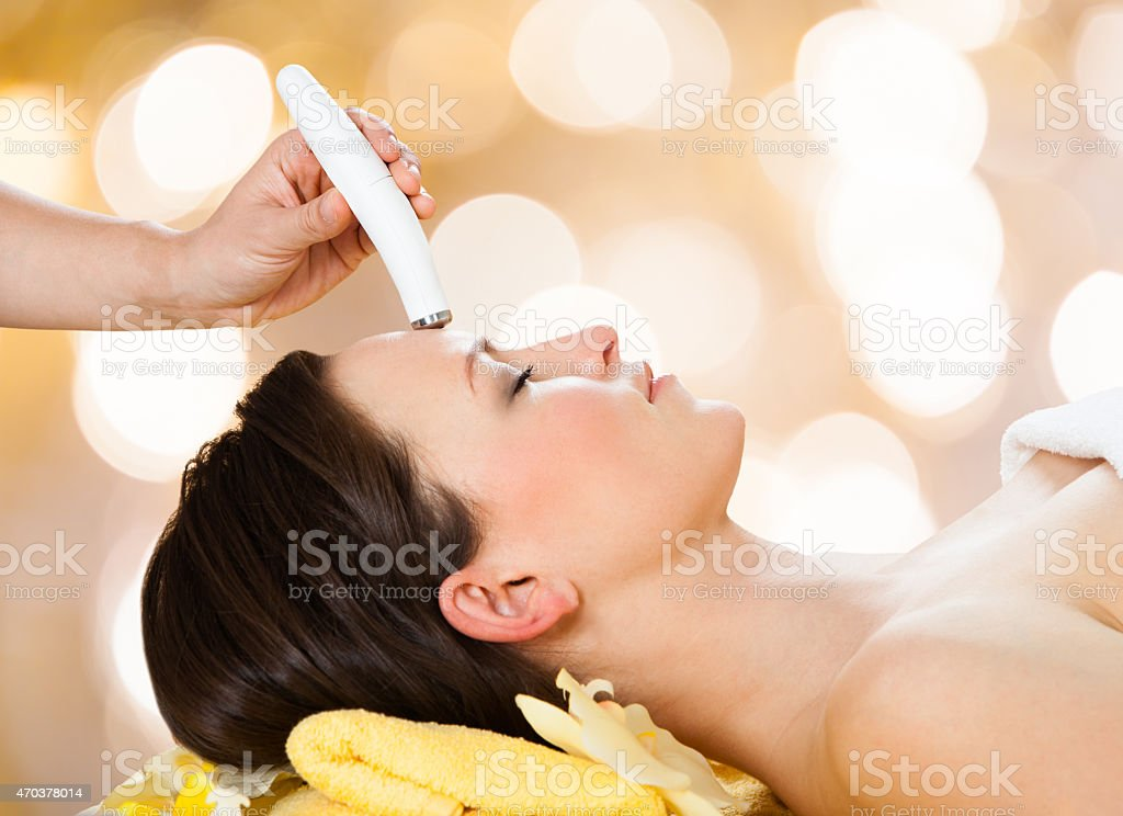 Woman Receiving Microdermabrasion Therapy stock photo