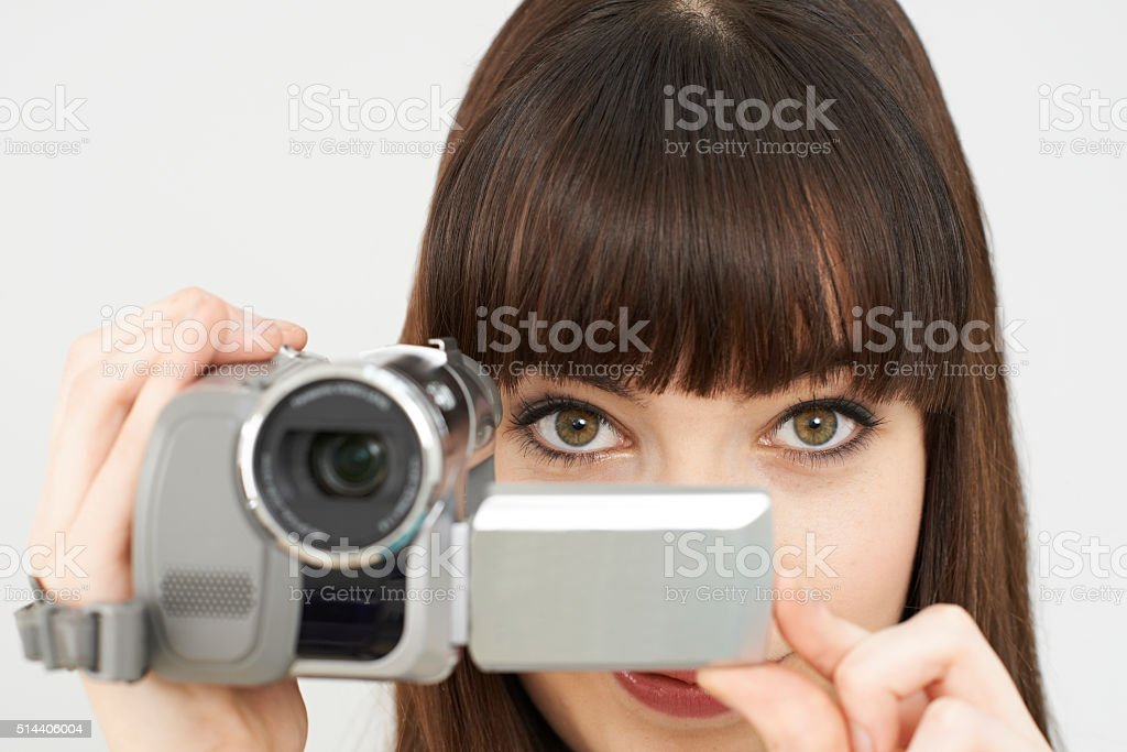 Woman Recording On Portable Video Camera stock photo
