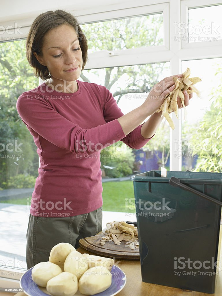 Woman recycling food waste royalty-free stock photo