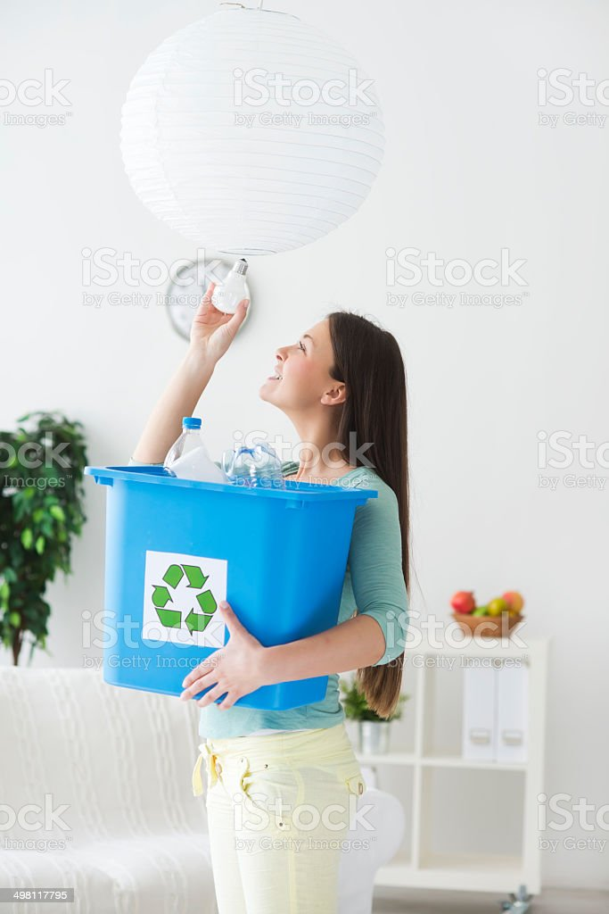 Woman recycling royalty-free stock photo