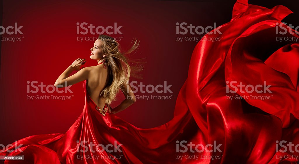 Woman Red Dress Dancing, Fashion Model Flying Cloth Fabric stock photo