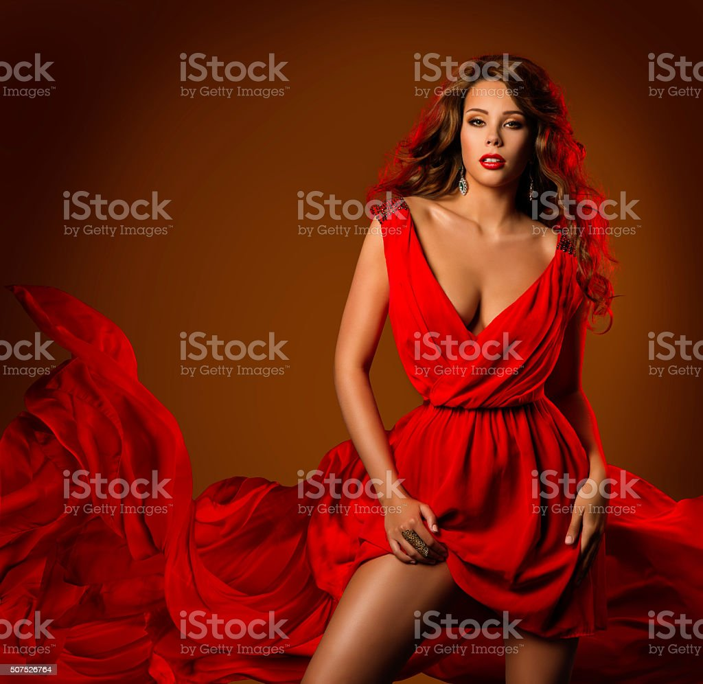 Woman Red Dress, Fashion Model Pose Flying Fabric Cloth stock photo