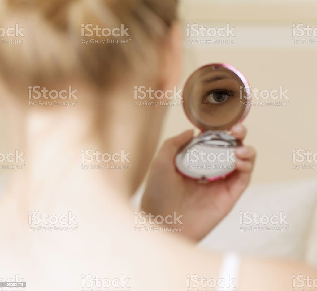 Woman reflection in mirror stock photo