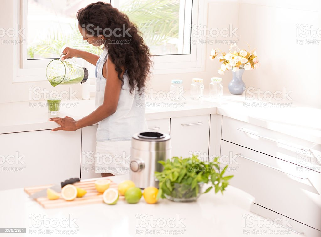 Woman refreshing with lemonade. stock photo