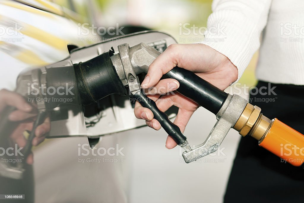 Woman refueling car with LPG gas stock photo