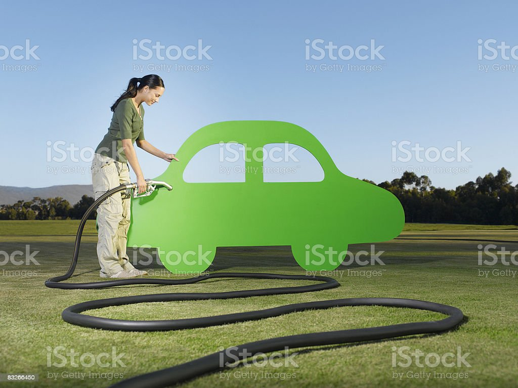 Woman refueling cutout car stock photo
