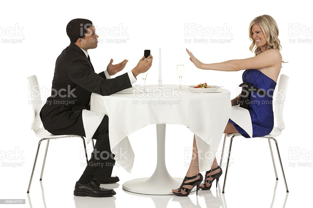 Woman refusing boyfriend's proposal royalty-free stock photo