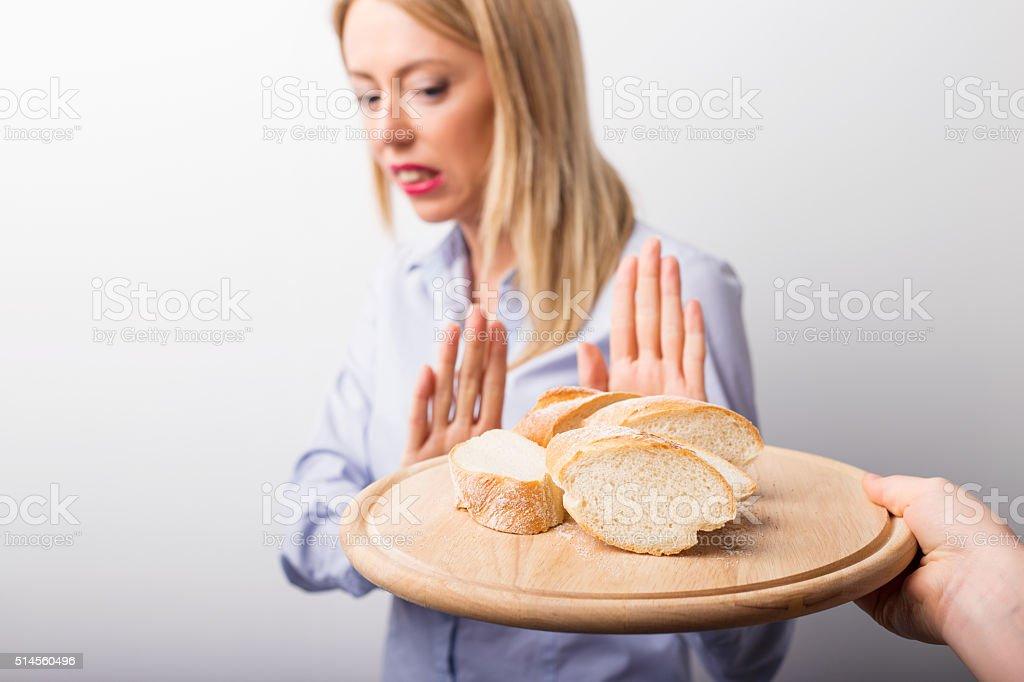Woman refusing to eat bread stock photo