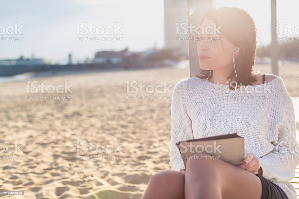 Woman Relax and Using a Tablet at the Beach stock photo
