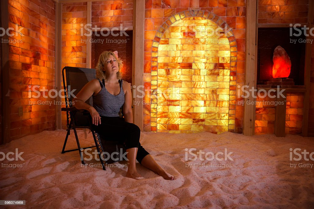 Woman relaxes in a salt cave stock photo