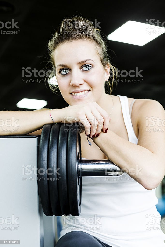 Woman relaxing after exercise with weights royalty-free stock photo