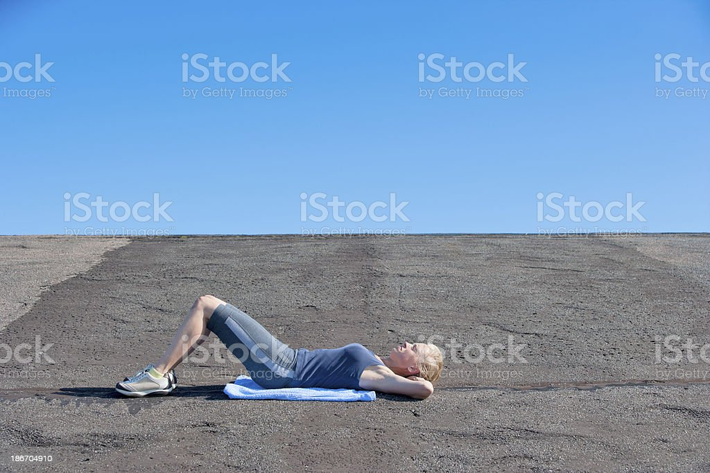 Woman relaxing after fitness royalty-free stock photo