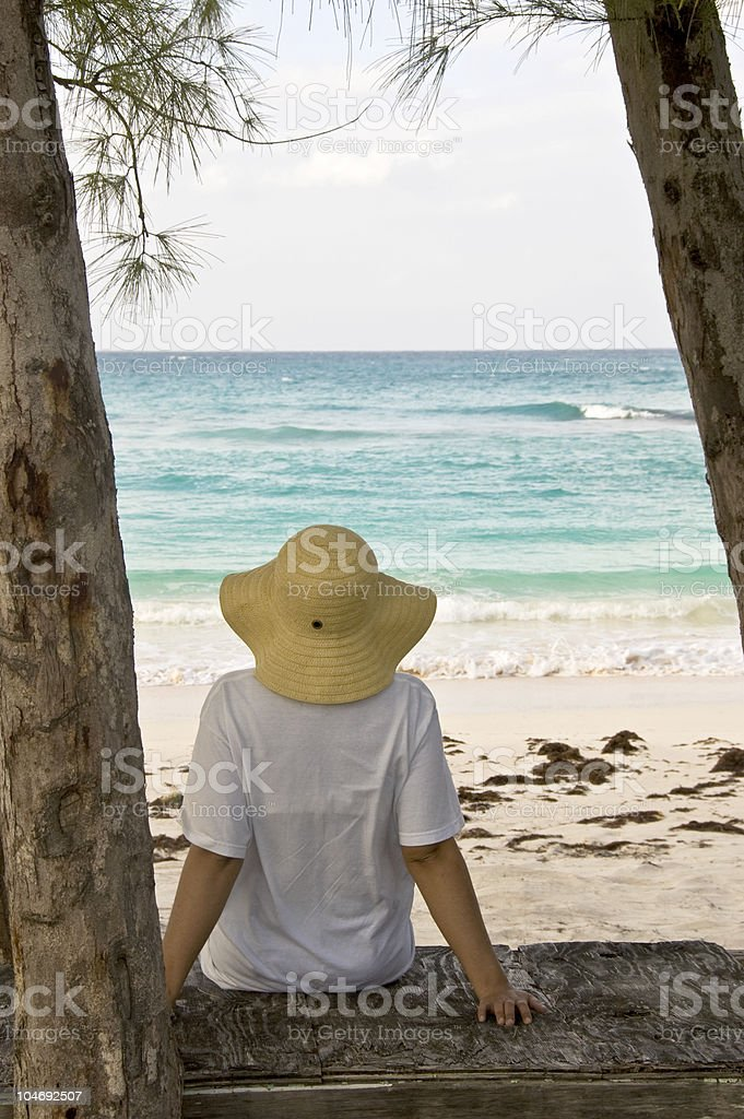 Woman relaxing and enjoying the beach royalty-free stock photo