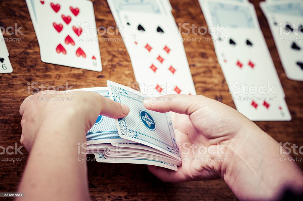 Woman Relaxing And Playing Solitaire stock photo