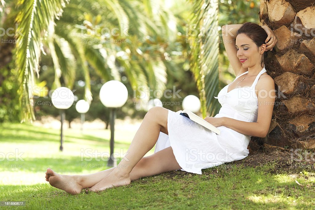 Woman relaxing and reading a book royalty-free stock photo