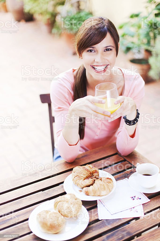 Woman relaxing and working on her terrace. royalty-free stock photo