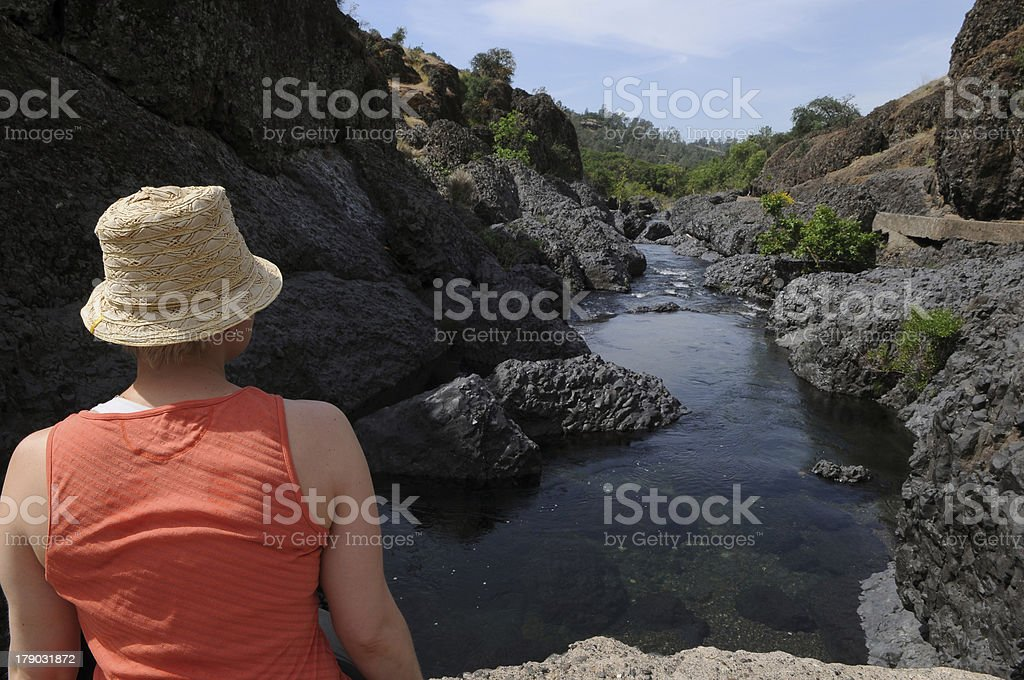 Woman Relaxing at a River royalty-free stock photo