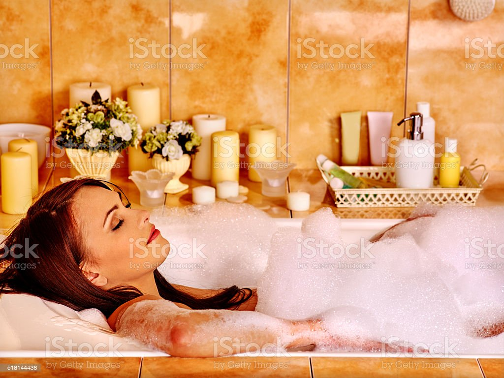Woman relaxing at  bubble bath stock photo