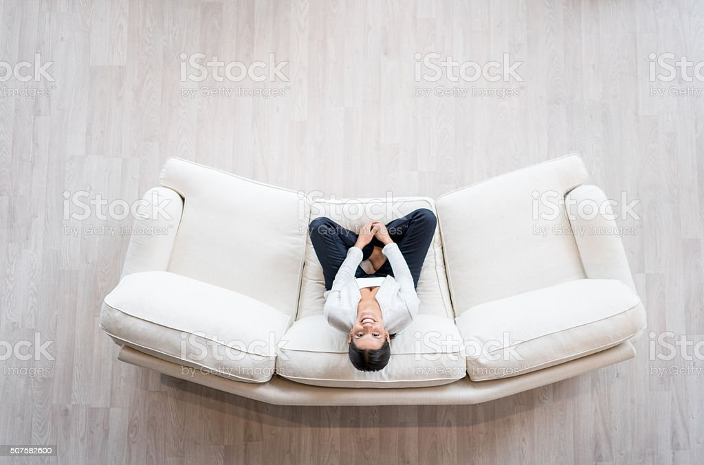 Woman relaxing at home on the sofa stock photo