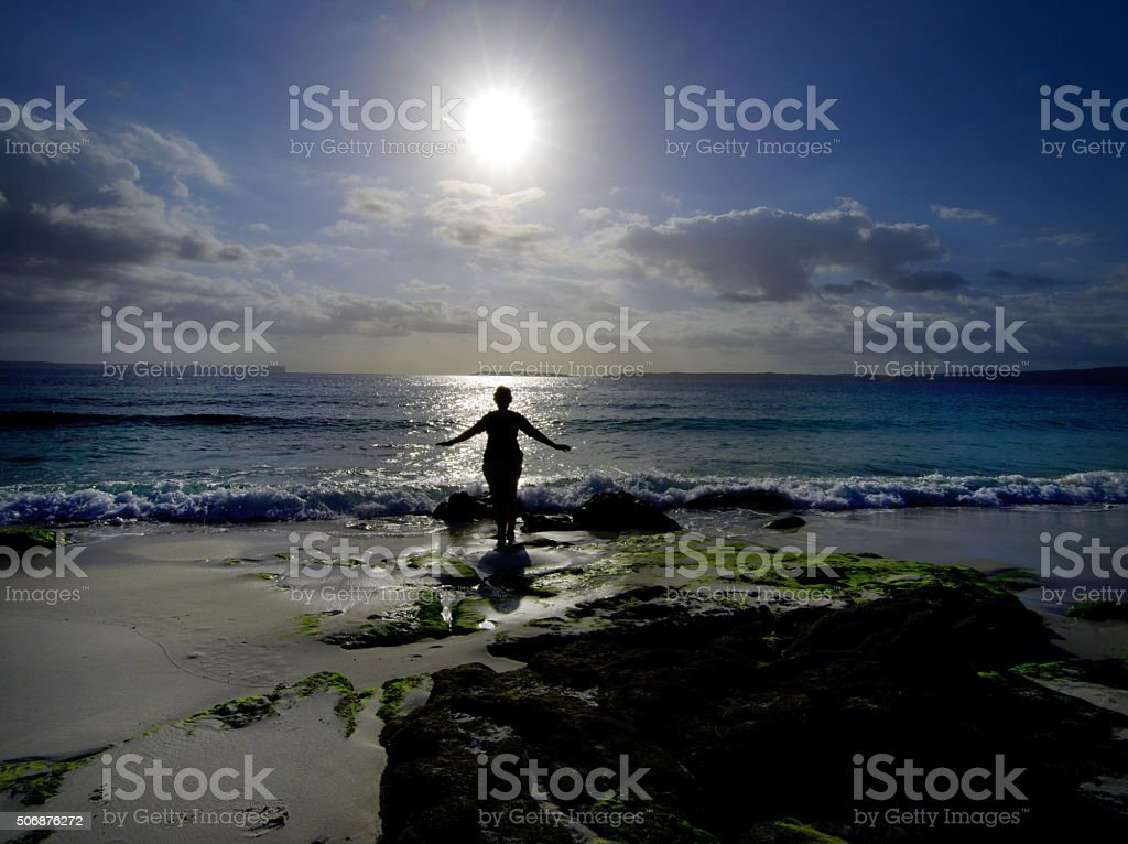 Woman relaxing at Hyams Beach stock photo