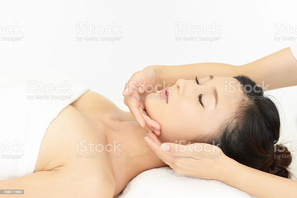 Woman relaxing at spa salon stock photo