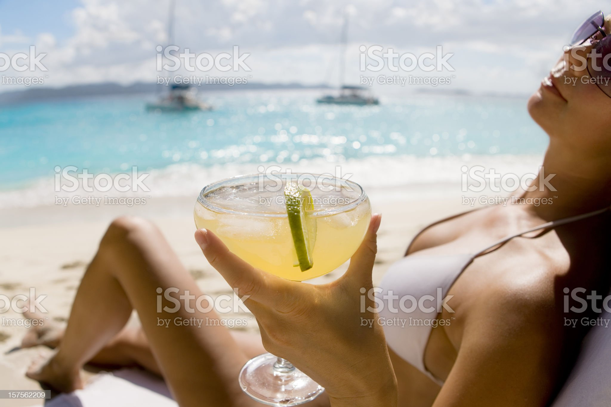 woman relaxing at the beach drinking margarita cocktail royalty-free stock photo