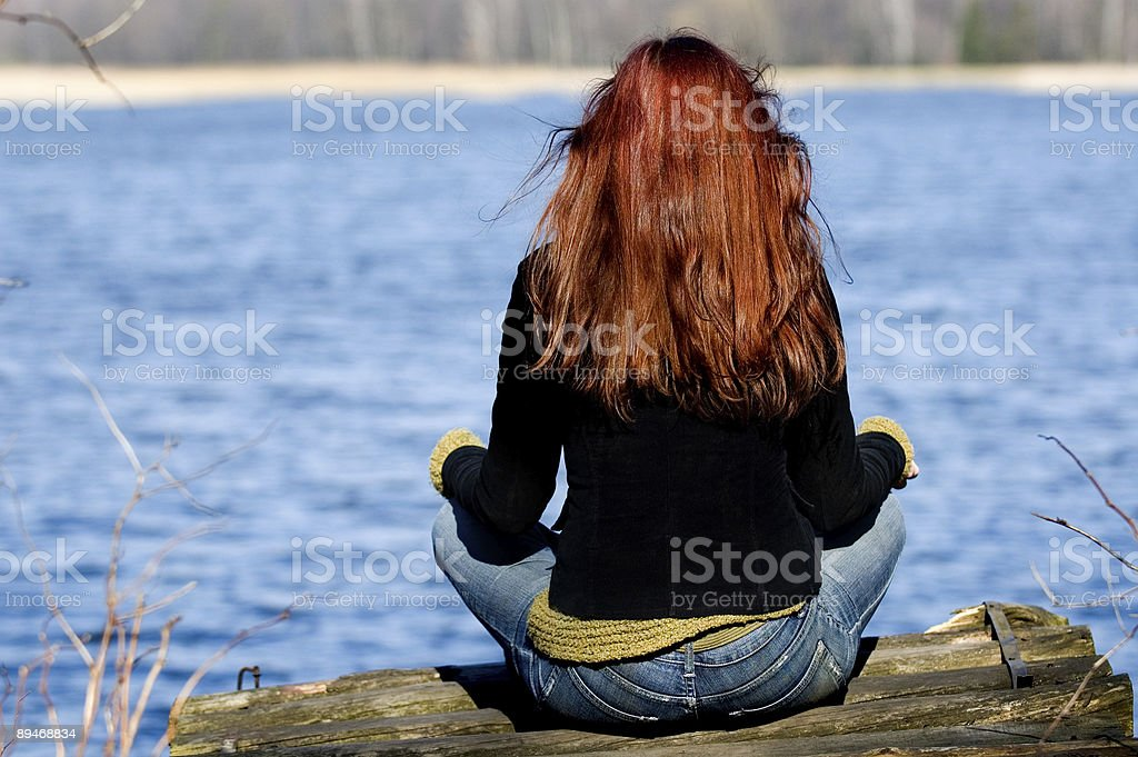 Woman relaxing at the lake royalty-free stock photo