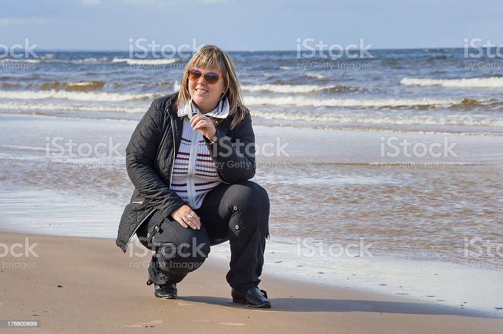 Woman relaxing at the sea. stock photo