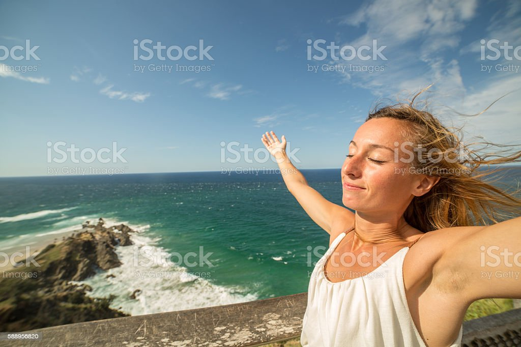 Woman relaxing by the sea stock photo