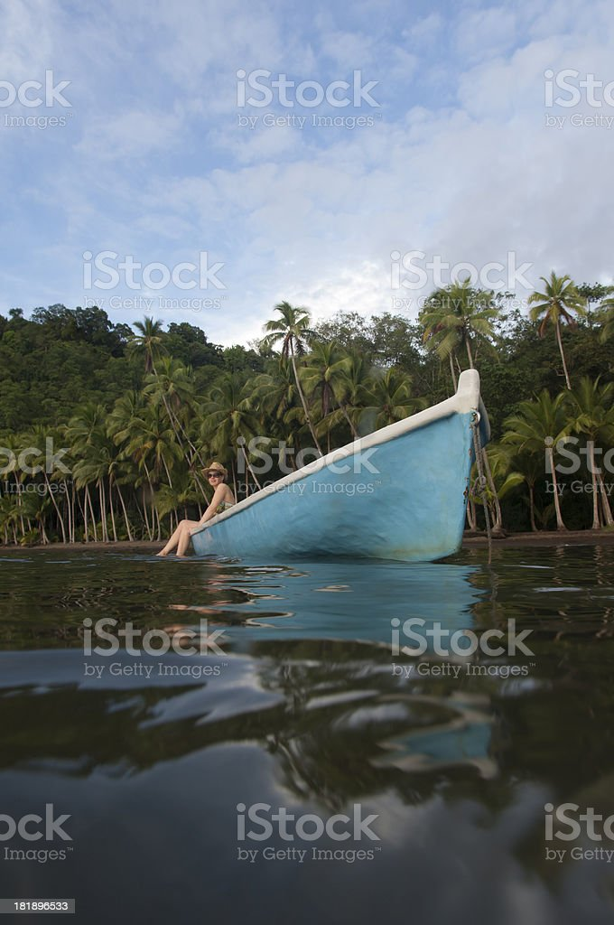 Woman relaxing in a boat stock photo