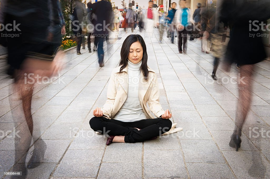 Woman Relaxing in a Crowded Street royalty-free stock photo