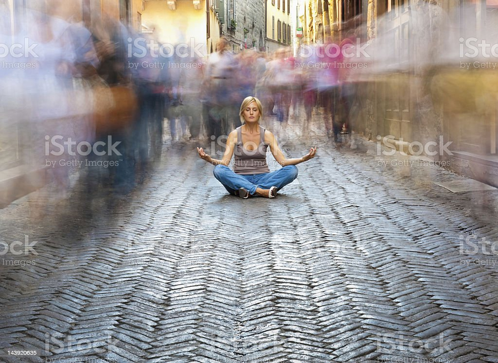 Woman Relaxing in a Crowded Street stock photo