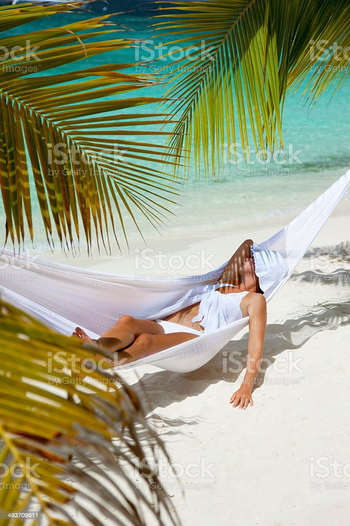 woman relaxing in a hammock at a Caribbean beach royalty-free stock photo