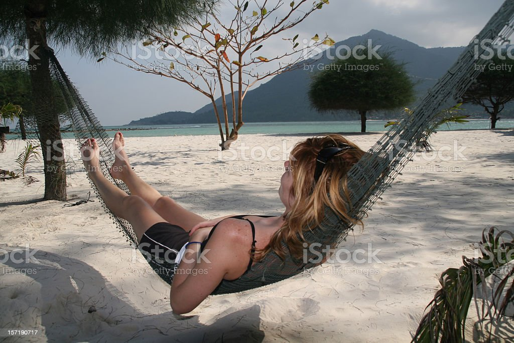 Woman Relaxing in a Hammock on Tropical Beach stock photo