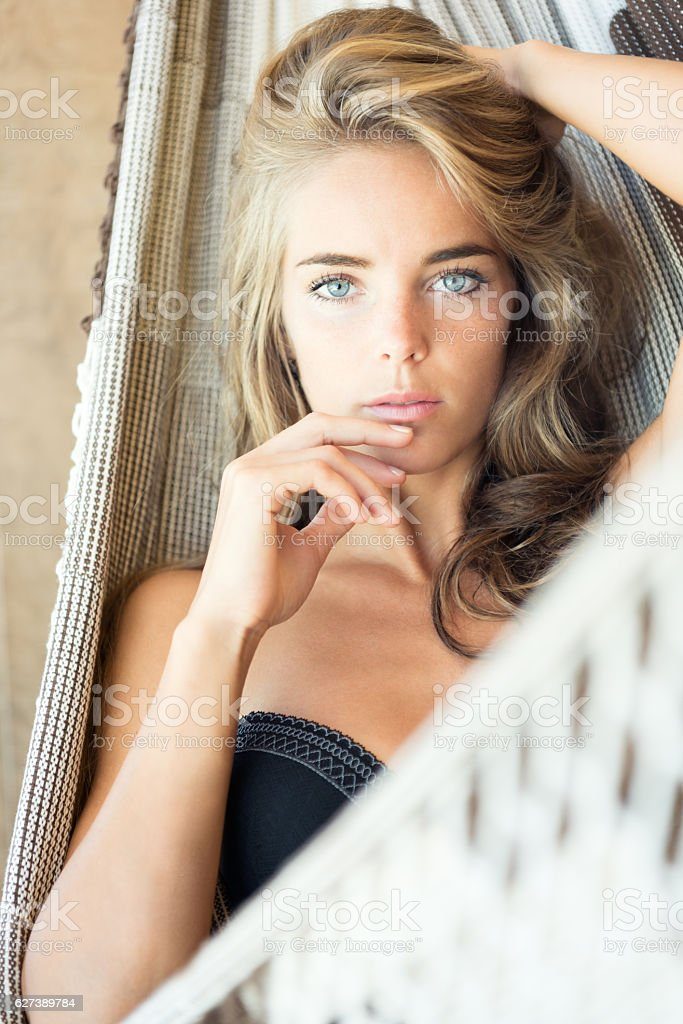Woman relaxing in a Hammock on Vacation stock photo