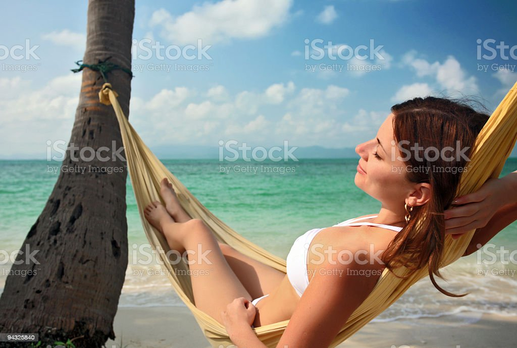 Woman relaxing in a hammock royalty-free stock photo