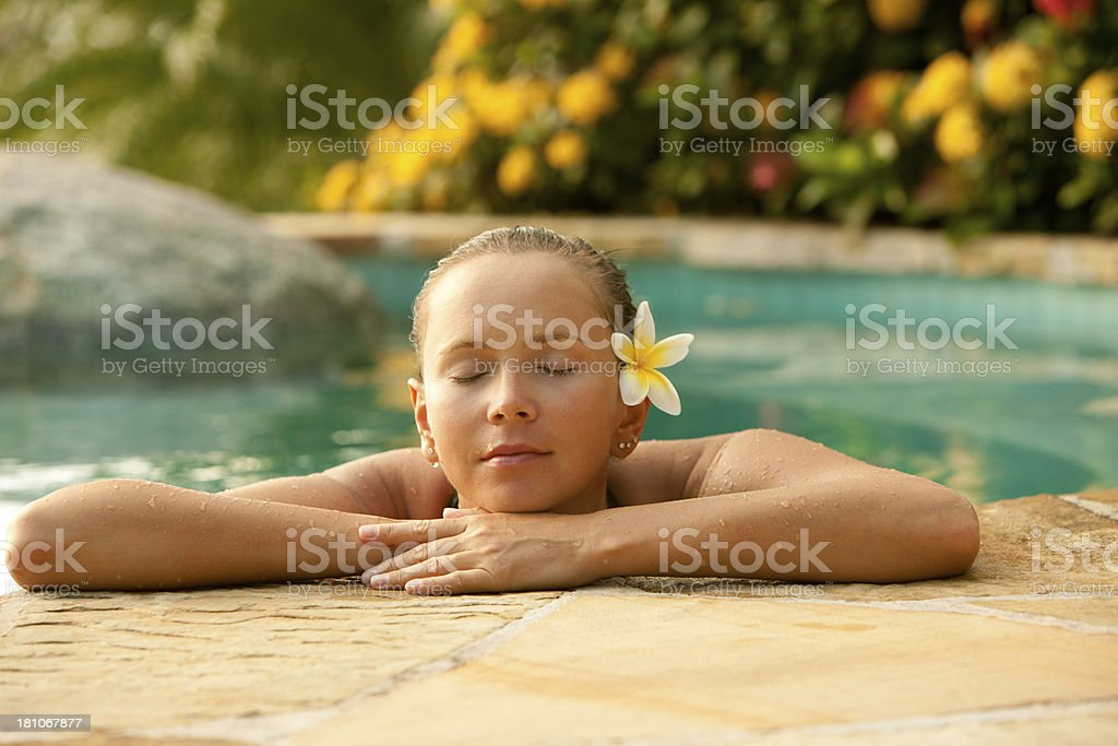 woman relaxing in a jacuzzi at the Caribbean spa resort royalty-free stock photo