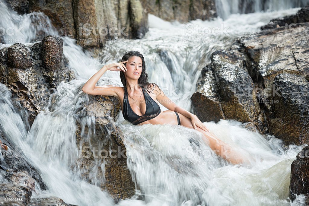 Woman relaxing in a natural Mountain Stream Spa stock photo