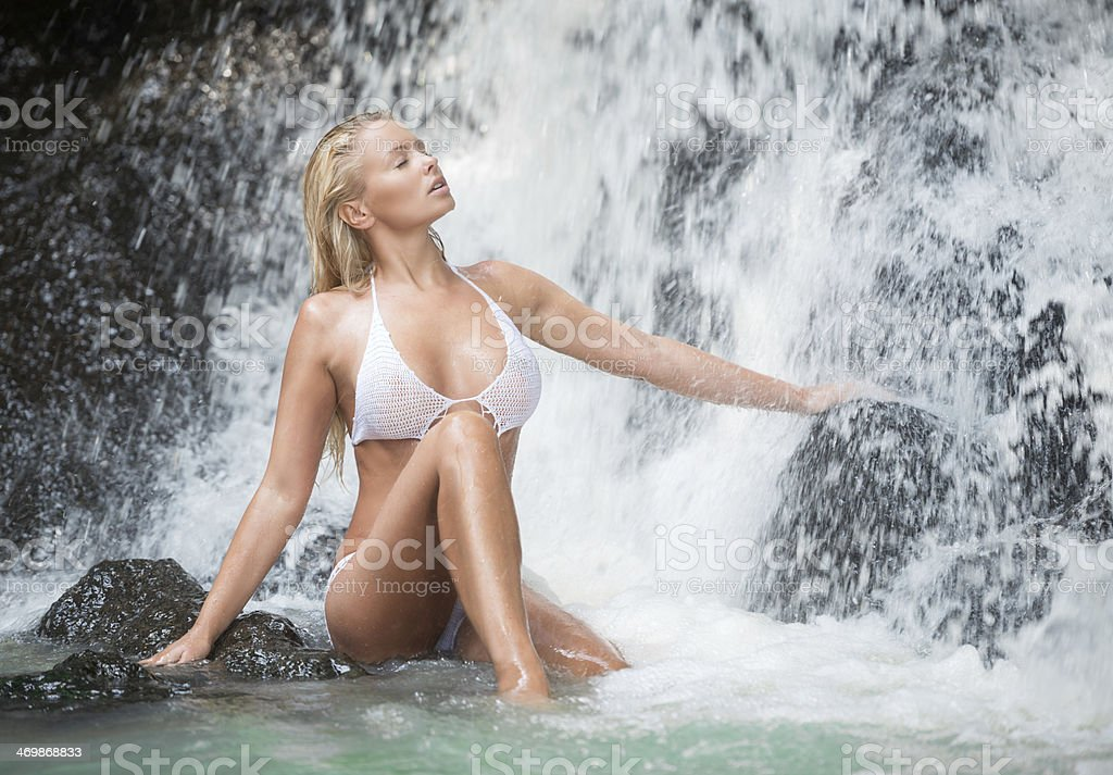 Woman relaxing in a natural Waterfall Spa stock photo