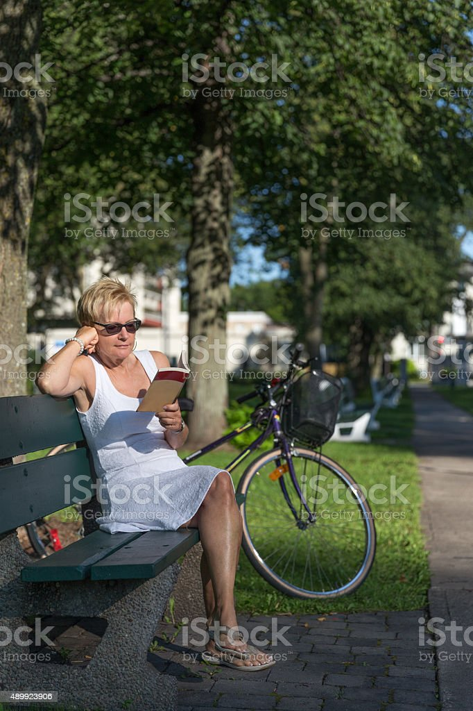 Woman relaxing in a park stock photo