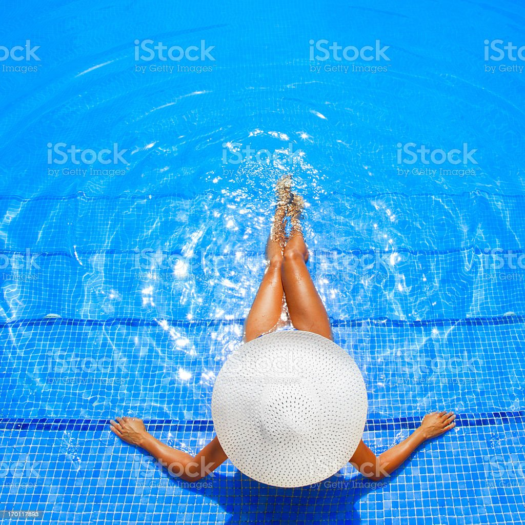 woman relaxing in a resort swimming pool royalty-free stock photo
