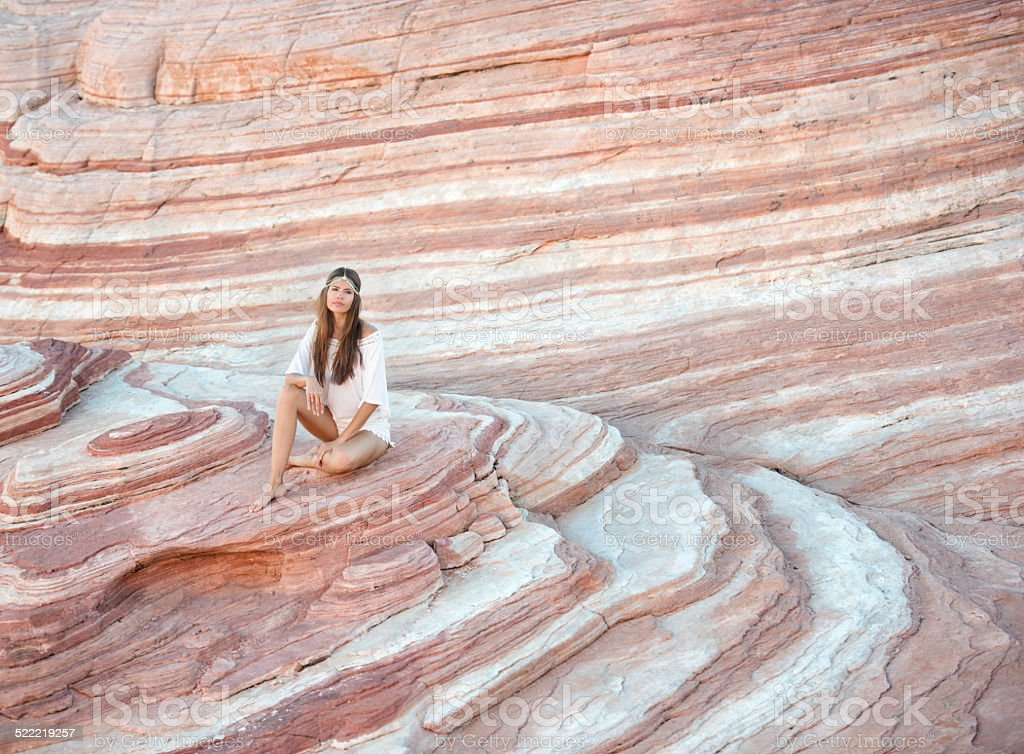 Woman relaxing in a Sand Stone Wave stock photo