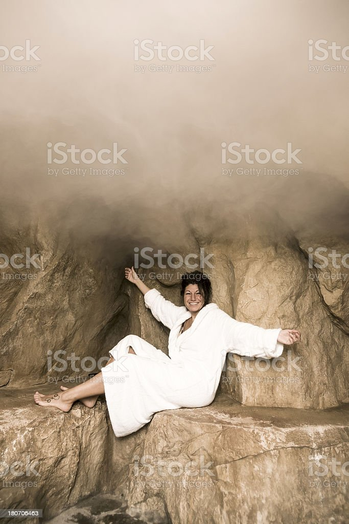 Woman relaxing in a sauna royalty-free stock photo