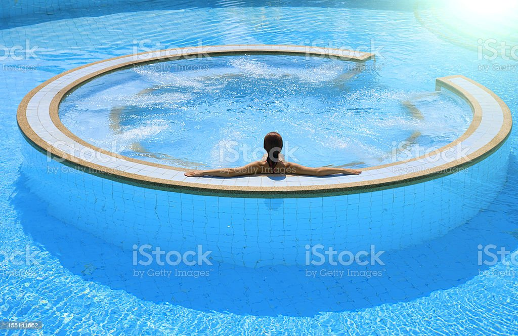 woman relaxing in an outdoor jacuzzi stock photo