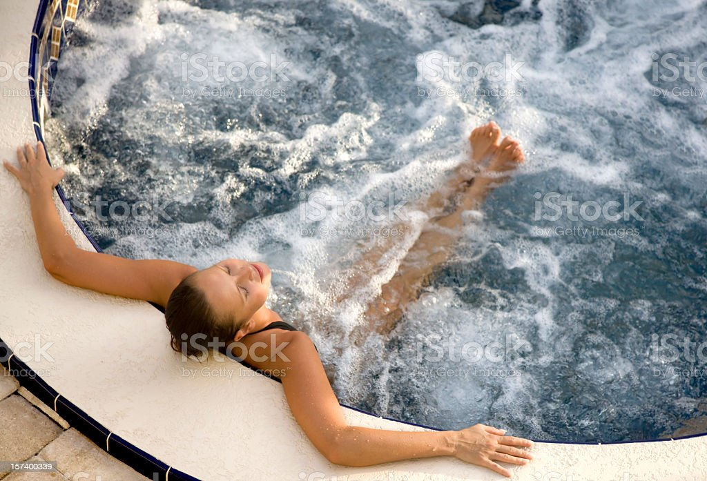 woman relaxing in an outdoor jacuzzi royalty-free stock photo