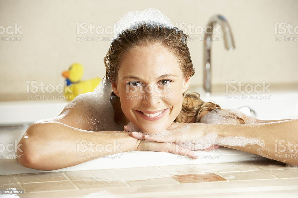 Woman Relaxing In Bubble Filled Bath royalty-free stock photo